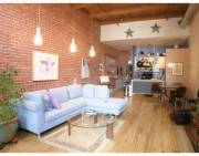 Spencer Loft with Cypress Floors, exposed brick, a patio and a separate bedroom.
